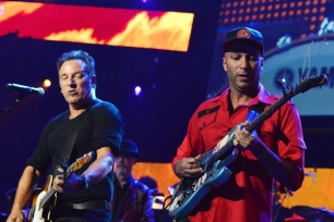 Bruce Springsteen and Tom Morello perform in Los Angeles, California. Rick Diamond/WireImage